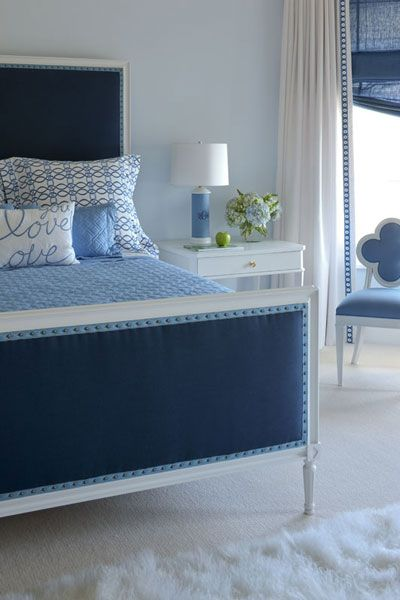 Gorgeous blue room. Love the grosgrain ribbon and nailhead trim on bed.