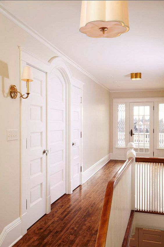 Benjamin Moore Manchester Tan is a light beige paint colour. Shown in hallway with tons of natural light