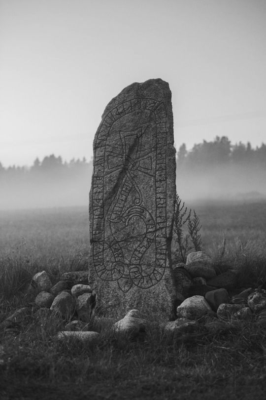 Rune stone in misty field