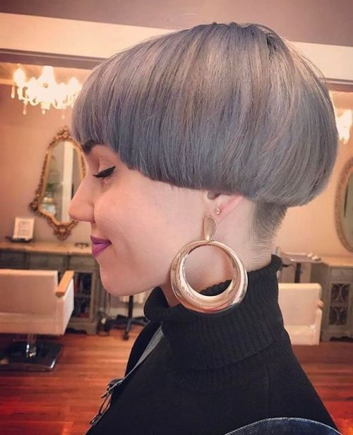 A grey bowl haircut, a perfect cut for a sissy especially when paired with gold hoop earrings. This sissy knows how cute he looks