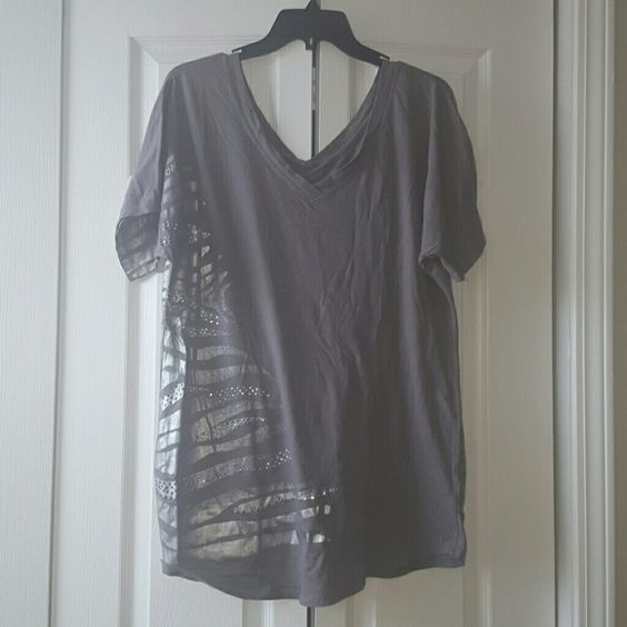 Oversize Metallic Animal Print V-Neck Soft grey oversize v-neck tee shirt with silver zebra stripes and silver sequins. New York & Company Tops Tees - Short Sleeve