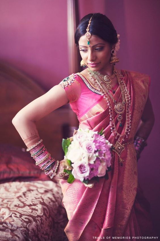 traditional indian bride wearing bridal saree and jewellery ...