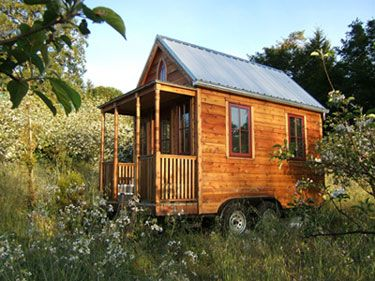 Jay Schafer's tiny house is built on a trailer and is fully portable.Good idea if you have a row!