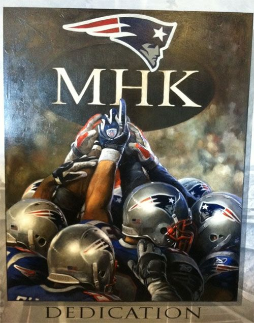 beautiful oil painting of #patriots pointing to MHK badge. their 2011 season was dedicated to Myra Kraft, the late wife of owner Robert Kraft.