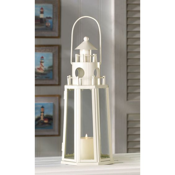 This lighthouse Candle Lantern is framed in Ivory Metal with Clear Glass Panels. #LighthouseCandleholders