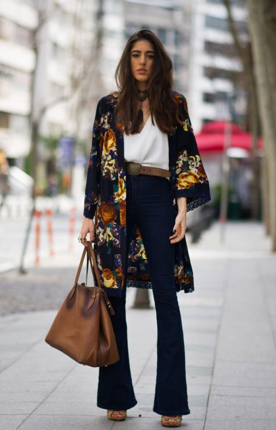 26 Ways to Style a Kimono for Spring - colorful kimono styled with belted high-waisted flares, a white blouse, and brown leather boho bag:
