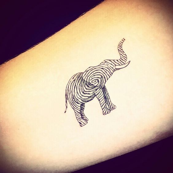 New elephant fingerprint tattoo on inner lower arm. About 2 inches long. Insane detail! --- I'd do a different animal, but same thought. Maybe a cat/horse/bunny?