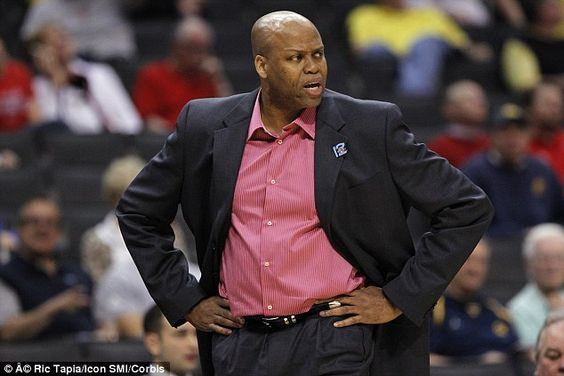 Out of office: First lady Michelle Obama's brother Craig Robinson has been fired as head coach for Oregon State University's men's basketball team. Pictured above at a tournament game against the University of Washington in Los Angeles in March 2012