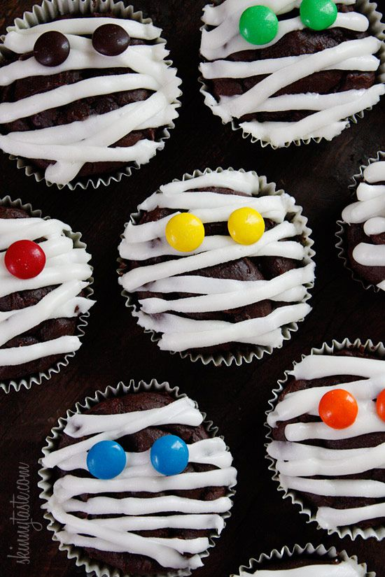 Low-Fat Chocolate Mummy Cupcakes - Chocolate mummy cupcakes with vanilla frosting, wouldn't these be so cute to bring to a Halloween party!