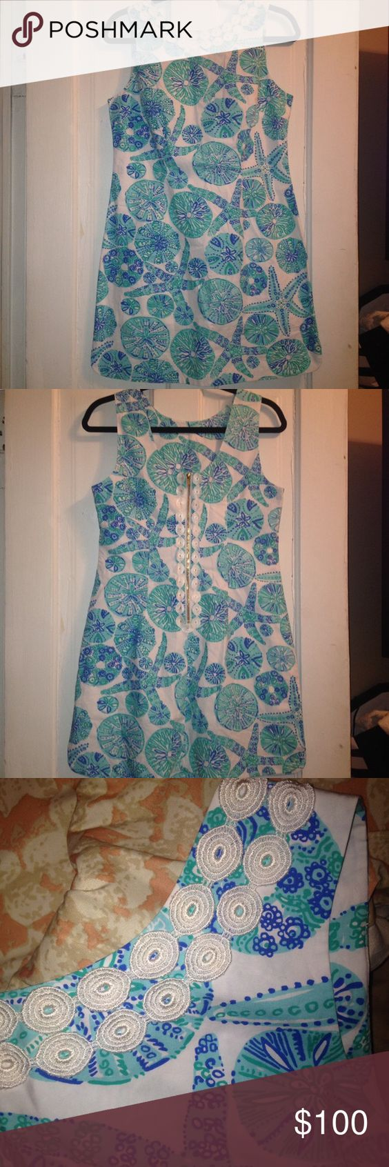 1OAK Lilly Pulitzer Sea Urchin Dress Beautiful one of a kind dress from Lilly Pulitzer for target, you won't find this dress anywhere else, if so...show me and price will drop...this one has white trimming around the neck line and a U shape cut at the bottom with a half a inch slit on each side of the dress. It also have a sheer ivory lining on the inside, ask any questing before purchasing, price reflect condition, in this case it's NWOT. Lilly Pulitzer for Target Dresses