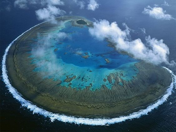 The Great Barrier Reef is the world's largest coral reef system composed of over 2,900 individual reefs and 900 islands stretching for over 2,600 kilometres.