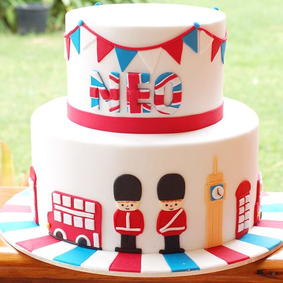 Birthday cake. Boy. London theme. British theme. Soldier. Neo. Bunting. Double decker. Bus. Big Ben. Post box.