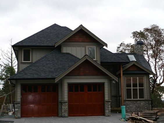 Like the mid tone house color with dark accent around for Black roof house