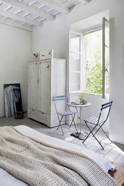 A cool white home with upcycled furniture