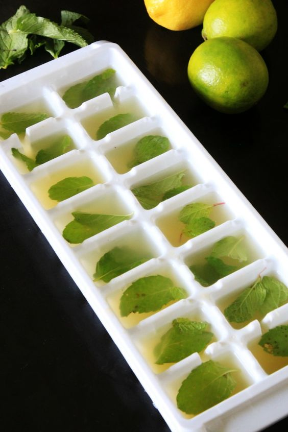 use a hand-held juicer to juice a few lemons or limes and then add one mint leaf per cube