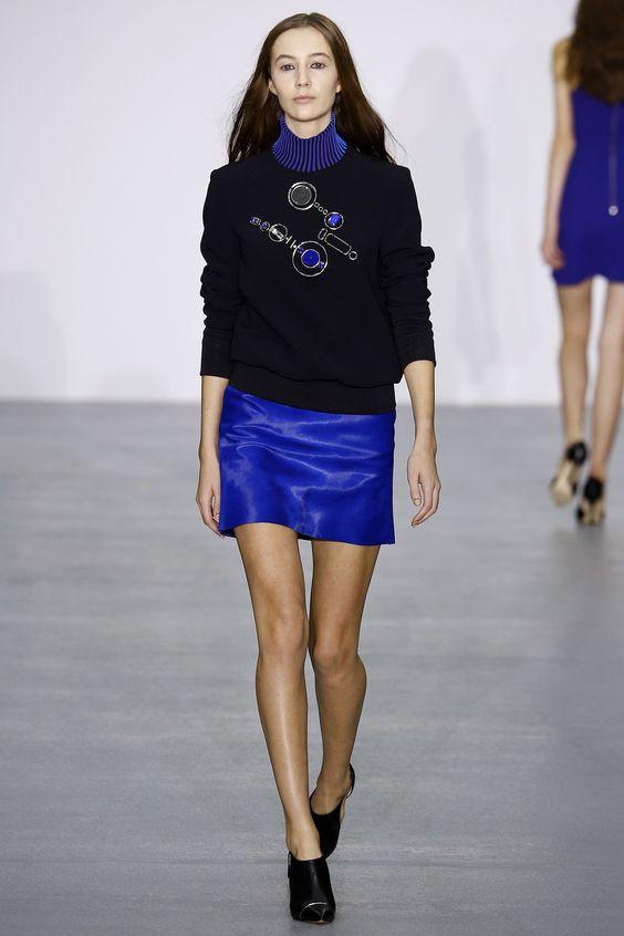 David Koma   Fall 2016 Ready-to-Wear   21 Black long sleeve sweatshirt and blue mini skirt