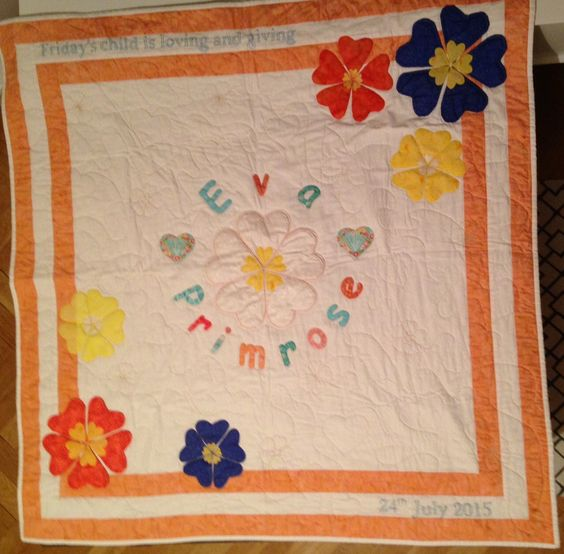 New Baby Quilt.  Extra Wadding in some flowers. Free Motion quilting with flowers, hearts and butterflys