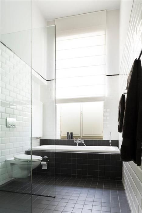 Great use of handmade subway tiles, with wall hung toilet pan. OWI // Office for Word and Image