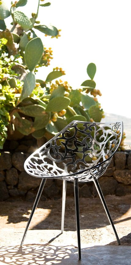 MISS LACY By Philippe Starck  Easy chair. Stainless steel casting flower patterned shell and tubular stainless steel legs.