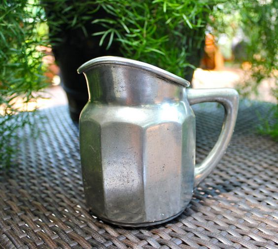 This is a very sturdy, solid pewter pitcher. It has a beautiful shape, no dings or dents. On the bottom on the inside there is a flower. The bottom has some words that are hard to made out but also has a small picture of a lion, and a star . Very unusual. It is 5 inches tall and 12 inches around, not including the handle. Feel free to ask questions. I take paypal, ship in the US via USPS