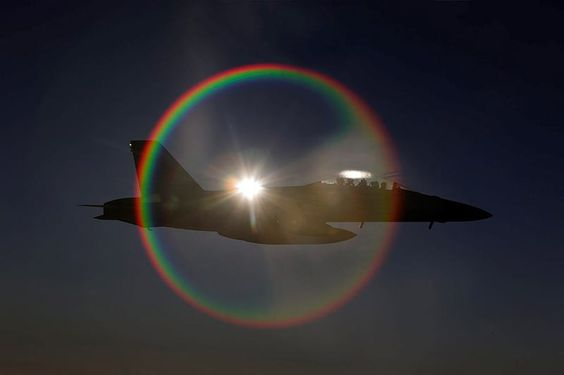 A Royal Australian Air Force F/A-18F Super Hornet, with the sun directly behind it, provides an unusual but spectacular sight during a mission in the skies over Iraq. Australia's Air Task Group (ATG) consisting of six Royal Australian Air Force (RAAF) F/A-18F Super Hornets, an E-7A Wedgetail Airborne Early Warning and Control aircraft and a KC-30A Multi-Role Tanker Transport aircraft continue to support Operation OKRA with missions in Iraq.