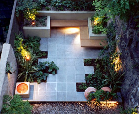 Neat way to make the best of space in a small urban like backyard setting ~ Seats, lighting, planters, and stone work.