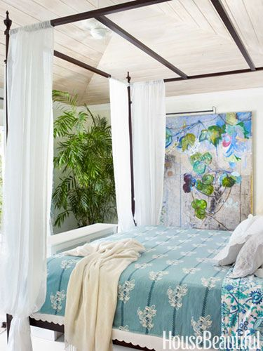 """The master bedroom looks out onto the pool, and when the pocket doors are pulled back, """"we feel like we're sleeping in a tent,"""" designer and owner Liza Pulitzer Calhoun says."""
