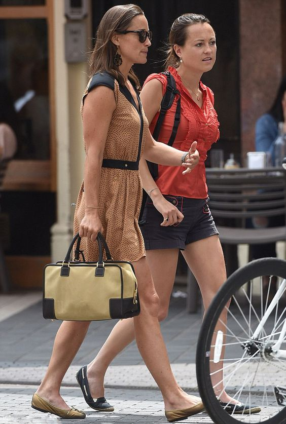 (L) Pippa Middleton, wore a flirty forties-inspired polka-dot playsuit which featured black cap sleeves, lapel and waistline detailing while out for lunch with a friend on 01.07.2014