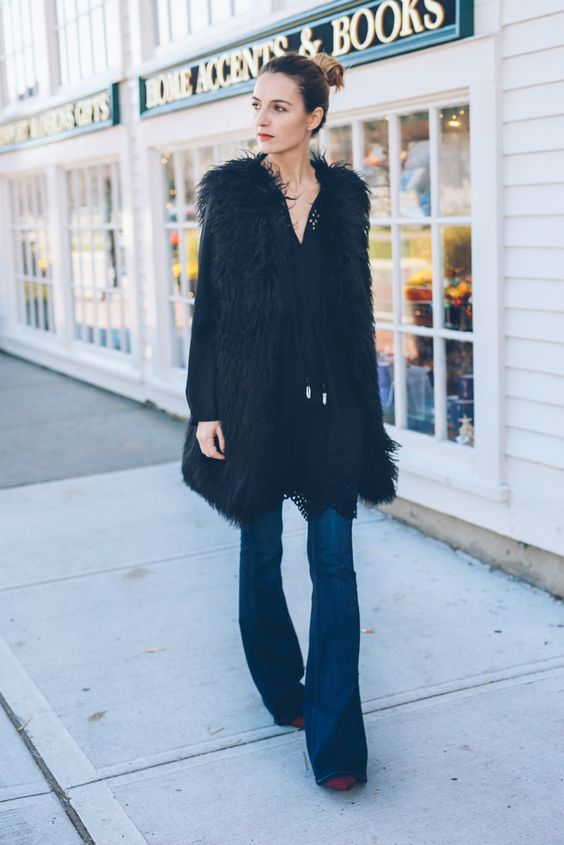 Flare jeans and faux fur vest for fall on Jess Kirby