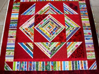 Finely Finished Quilts  Connie used the Roman Stripes pattern and selvages to make this fun quilt!