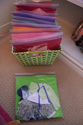 How to store American Girl Doll clothes -- gallon ziplocs + scrap paper, stack vertically in a pretty bin: