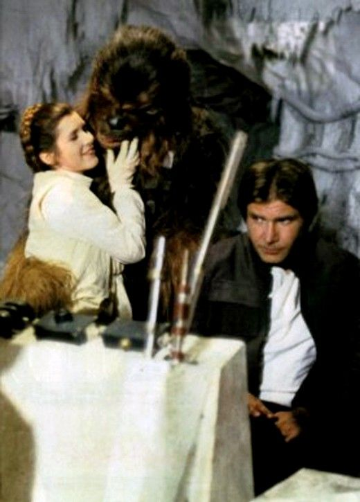 Princess Leia kissing Chewbacca with Hans Solo