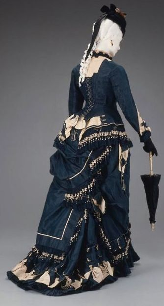dark blue and tan victorian / steampunk style dress with hat and parasol. I wish I had this in my closet...