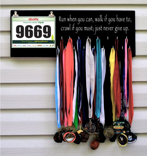 Medal and bib display for runners. I want to make my own, I don't like any of the quotes that go along with the ones I've seen. I just want my name on it