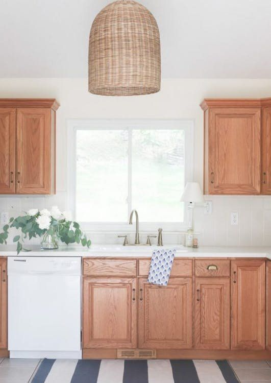 How To Brighten Up A Dark Kitchen Without Painting 7 Ideas To Steal From Rental Kitchens Rocking Their Oak Wood Cabinets Oak Kitchen Oak Cabinets Kitchen Remodel Small