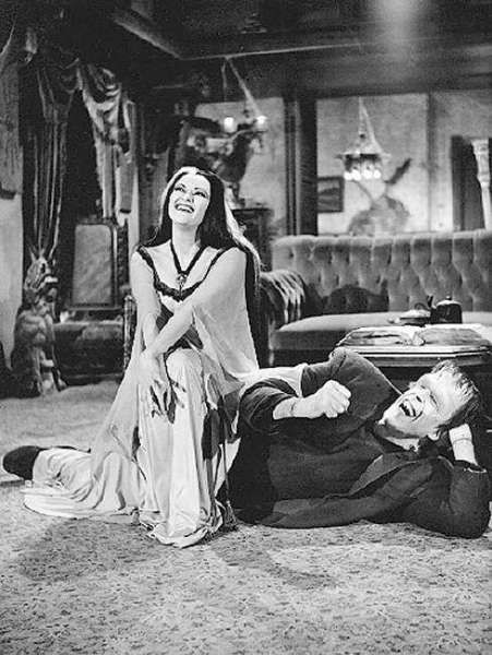 Lily Muster (Yvonne De Carlo) and Herman Munster (Fred Gwynne) share a laugh on the set of TV's The Munsters.