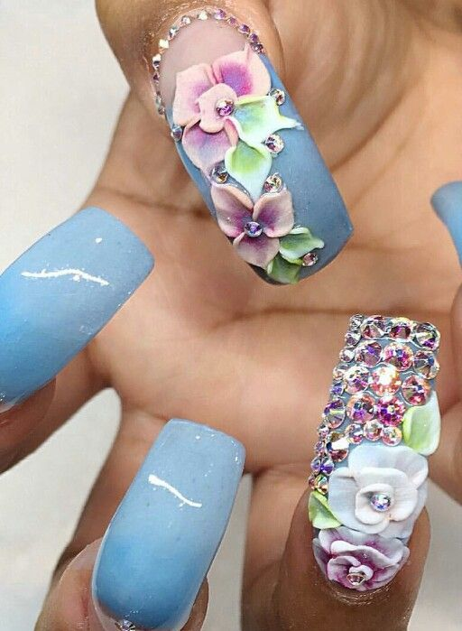 Blue floral rhinestone nails @nails_by_verovargas