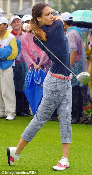 Action! The actress played the part of preppy golf pro perfectly in her navy blue short sleeved button up and plaid capri trousers
