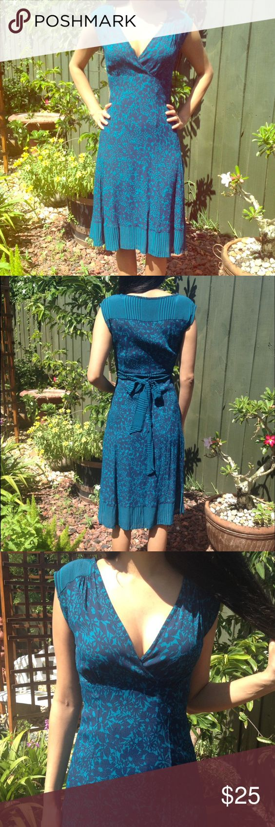 Versatile turquoise and navy dress This is from popular and very good quality British brand Monsoon. The dress is lined and closes with a side zipper. Very versatile dress - can be dressed up or down. In great condition, couldn't spot any imperfections. Color is turquoise and navy. UK size 8, US size 4. Monsoon Dresses Midi