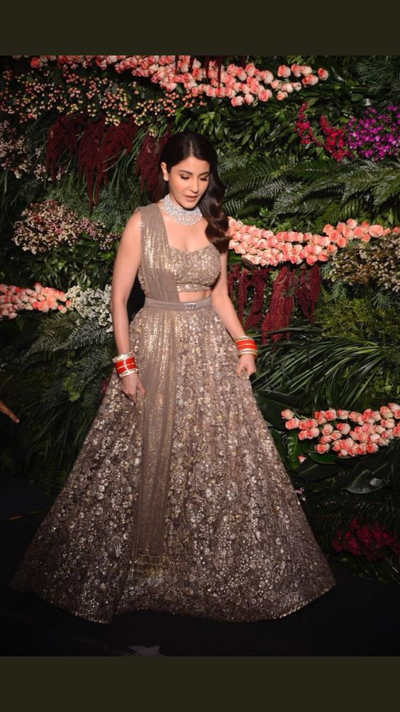 Anushka Sharma for her Mumbai reception. Wearing Sabyasachi. | cut organza flowers, textured sequins and beaten silver threads in an ethereal smoky grey lehenga. | reception wear ideas for Brides | Reception Dress Ideas for Indian Brides |Function Mania