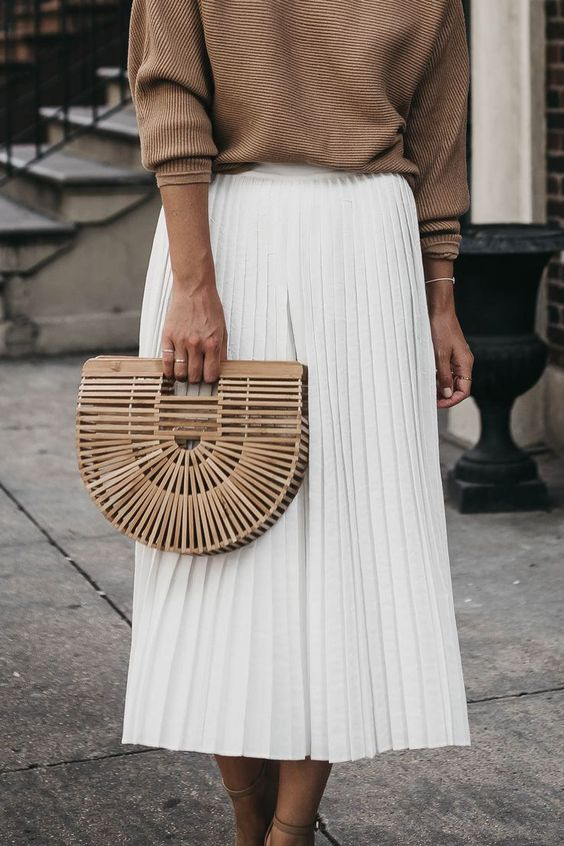 Effortless Summer Style   White Pleated Midi Skirt, Light Neutral Summer Sweater, Cult Gaia Bamboo Clutch