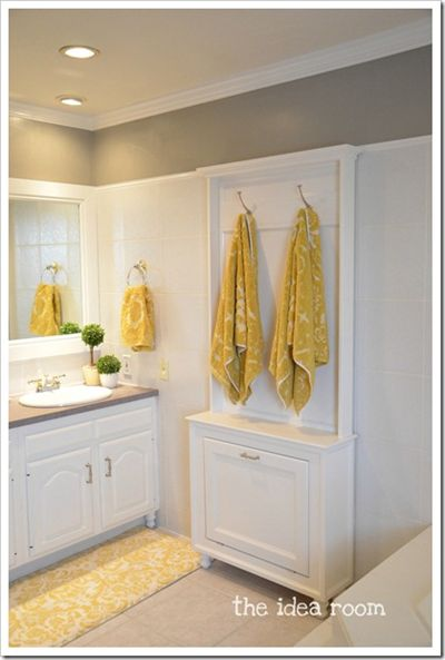 What a great idea!  I cod use a place for my blow dryer!  Towel Rack Hair Tool Cabinet This cabinet holds towels on top, hair tools hidden neatly below.