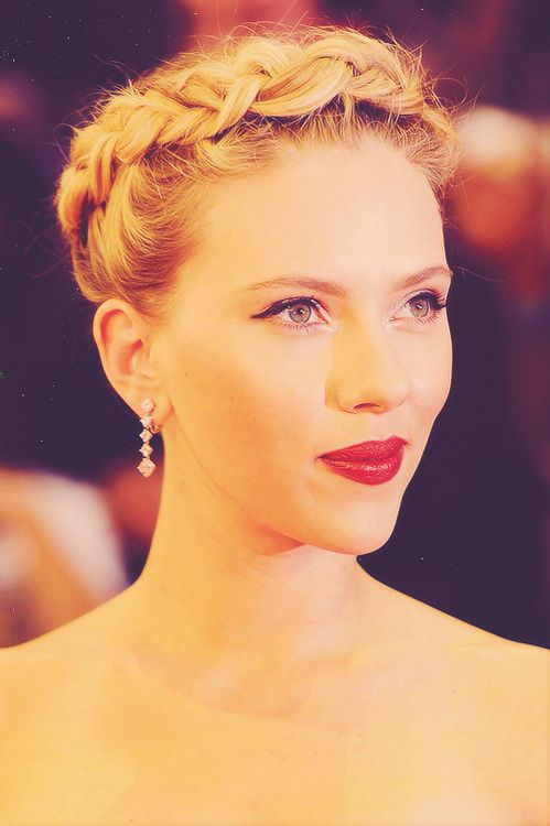 Scarlett Johansson attending the London premiere of The Avengers on April 19, 2012