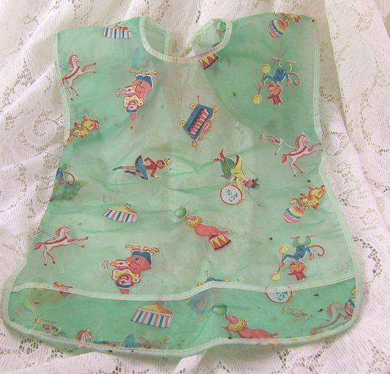 Vintage plastic baby bib with circus theme. Adorable!