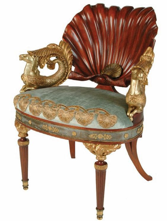 VENUS CHAIR An Austro-Hungarian ormolu-mounted mahogany and parcel-gilt armchair. All the elements of this chair are attributes of Venus, Goddess of Love. Born of the sea, Venus floated ashore in a scallop-shell. Drawn by hip-pocampi, fabled creatures with the fore-parts of a horse and the hind-parts of a fish, the scallop-shell becomes the vessel of the marine deities. The flaming torches which appear in the seat and form the front legs signify the fire of love. want so fucking bad my god: