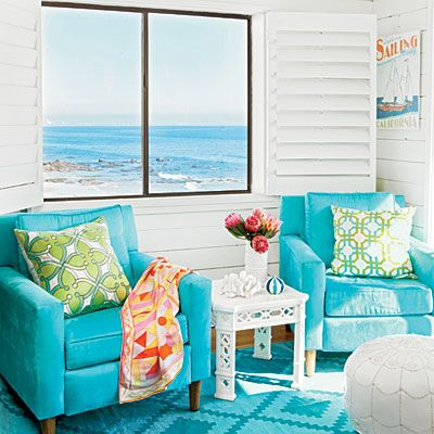 Bold turquoise defines this living room. Anya Sarre introduced vibrant rugs  and chairs that set - Beach Couture In Malibu Turquoise, Plages Et Salons