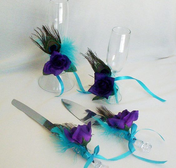 Hey, I found this really awesome Etsy listing at http://www.etsy.com/listing/102915576/peacock-wedding-accessory-set-decor-for