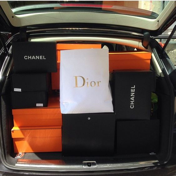 Trunk full of designer shopping bags