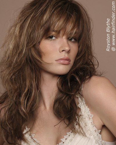 This long layered haircut is deeply textured with razor-cut ends for softness and a choppy, high-impact arrangement. The rich brown color is   accented with soft, beige highlights and the styling is achieved through a diffused blow-dry technique with a brush and a soft-hold   styling product. Gentle back-combing at the scalp and light ruffing with a bristled brush can add volume in the areas where it is   desired, and provide a balanced silhouette.