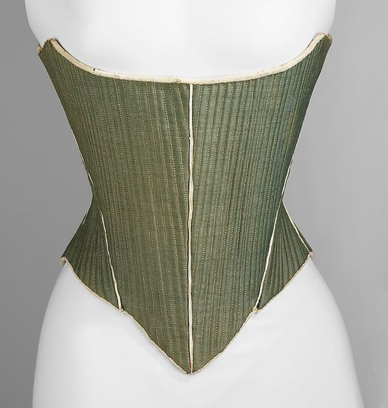 Corset Date: ca. 1780 Culture: American Medium: wool, leather, linen, reeds Dimensions: Length at CF: 14 1/4 in. (36.2 cm) Credit Line: Brooklyn Museum Costume Collection at The Metropolitan Museum of Art, Gift of the Brooklyn Museum, 2009; Gift of E. A. Meister, 1950 Accession Number: 2009.300.3100a, b